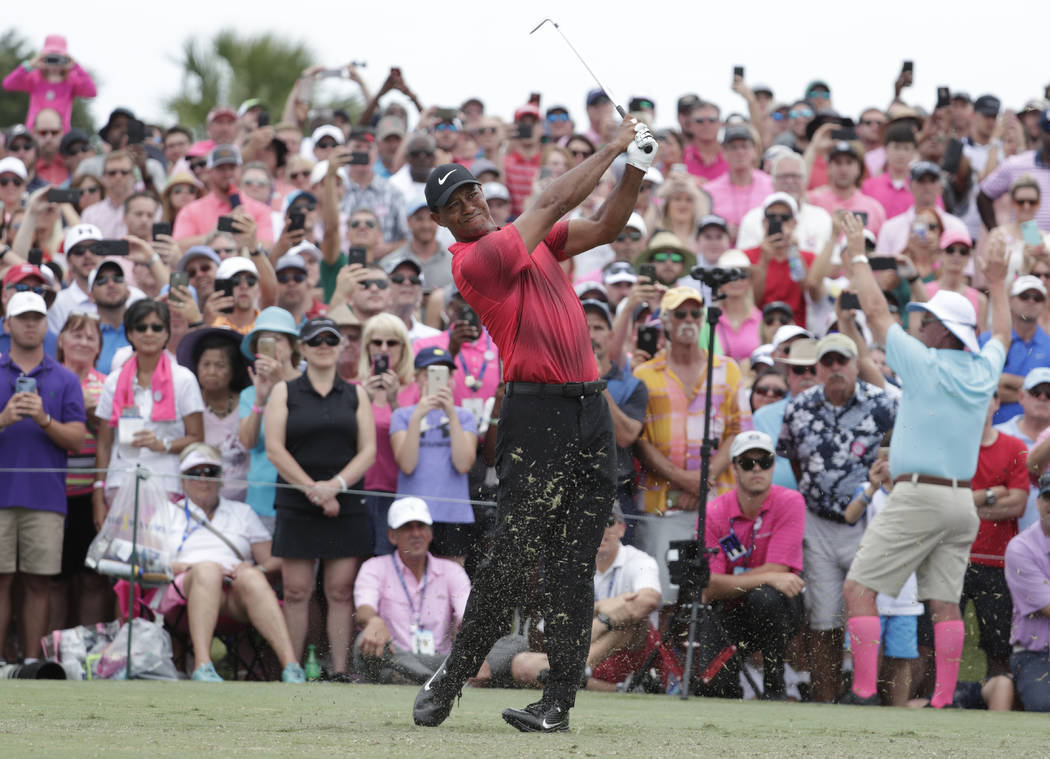 Tiger Woods hits from the third tee, during the final round of The Players Championship golf tournament, Sunday, May 13, 2018, in Ponte Vedra Beach, Fla. (AP Photo/Lynne Sladky)
