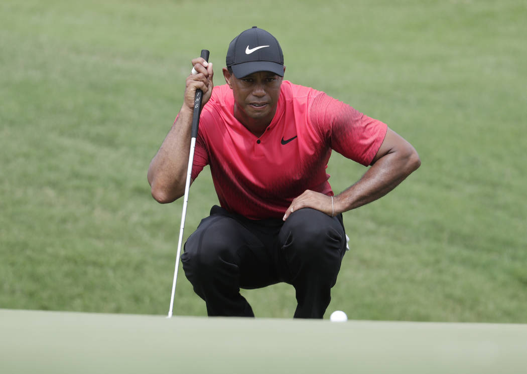 Tiger Woods looks at his shot on the ninth green, during the final round of The Players Championship golf tournament, Sunday, May 13, 2018, in Ponte Vedra Beach, Fla. (AP Photo/Lynne Sladky)