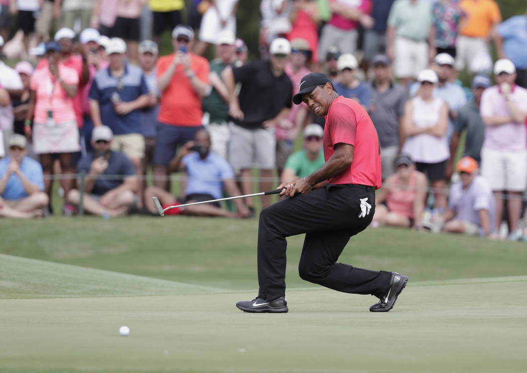 Tiger Woods reacts to a missed putt on the 11 green, during the final round of The Players Championship golf tournament, Sunday, May 13, 2018, in Ponte Vedra Beach, Fla. (AP Photo/Lynne Sladky)