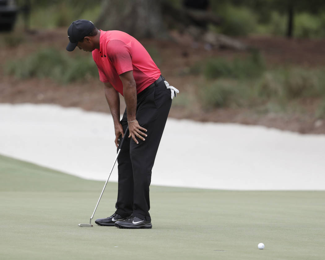 Tiger Woods looks away as he misses a putt on the 14 green, during the final round of The Players Championship golf tournament Sunday, May 13, 2018, in Ponte Vedra Beach, Fla. (AP Photo/Lynne Sladky)