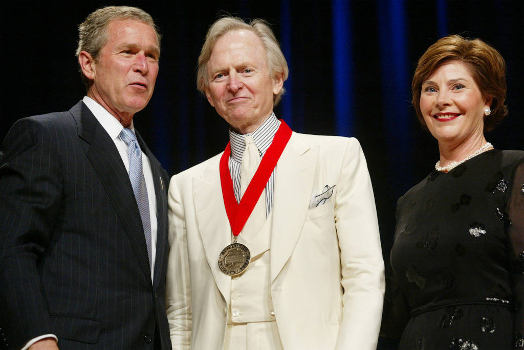 FILE - In this April 22, 2002 file photo, President Bush, left, poses with author Tom Wolfe, center, and first lady Laura Bush during the National Endowment for the Arts National Medal Awards cere ...