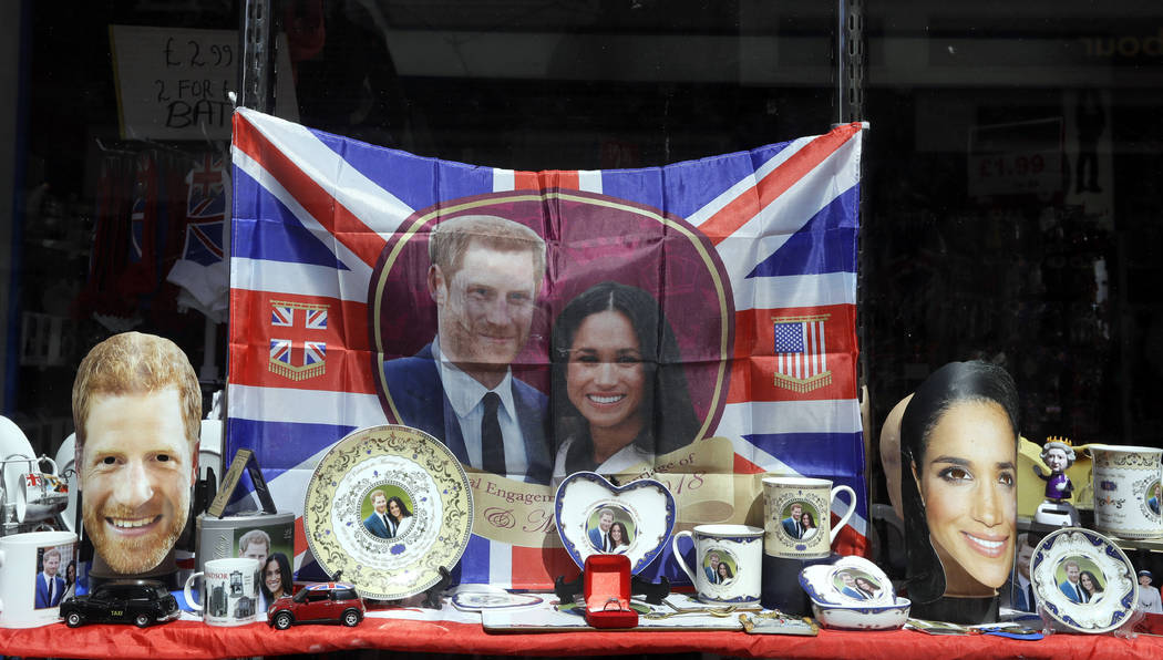 Merchandise is displayed for sale in a shop window in Windsor, England, Monday, May 14, 2018. Preparations are being made in the town ahead of the wedding of Britain's Prince Harry and Meghan Mark ...