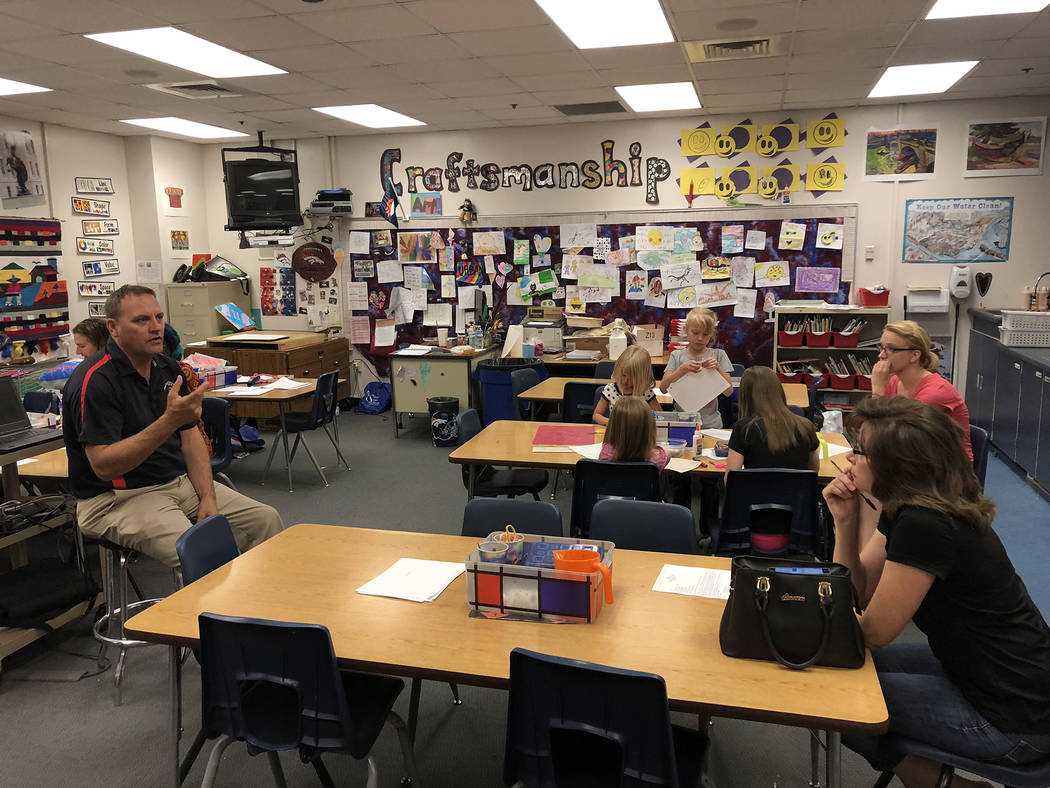 Stanford Elementary School Principal Ryan Merritt explains to his school organizational team on Tuesday how he's going to balance his school budget in light of recent cuts mandated by the Clark Co ...