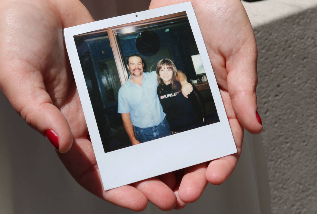 Breanna Boppre holds a photo of herself and her father, Scott Schlingheyde, in Las Vegas, Thursday, May 10, 2018. The photo was taken in a prison visiting room; Boppre doesn't recall how old she w ...