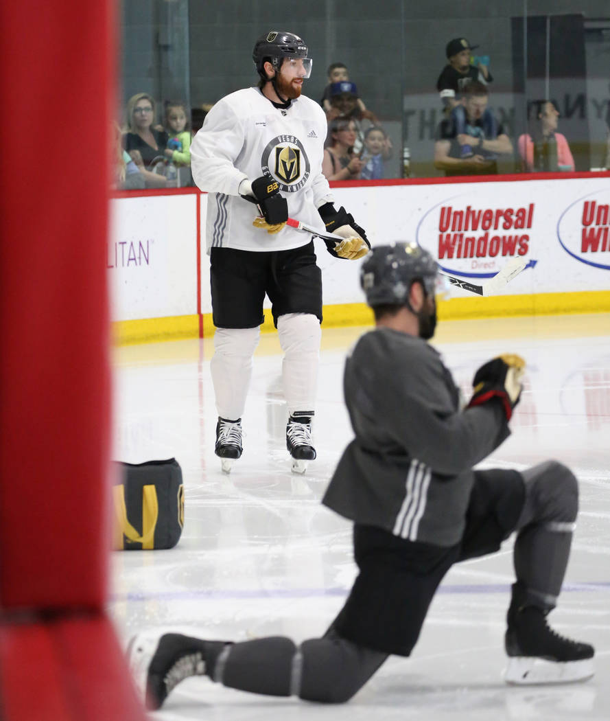Golden Knights defenseman Brad Hunt, stretches as teammate James Neal skates during optional team practice at City National Arena on Tuesday, May 15, 2018, in Las Vegas. Bizuayehu Tesfaye/Las Vega ...