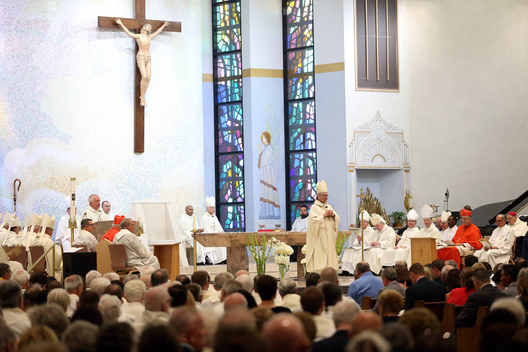 Bishop George Leo Thomas, center, during his installation as the third Bishop of Las Vegas, at The Shrine of the Most Holy Redeemer in Las Vegas, Tuesday, May 15, 2018. Erik Verduzco Las Vegas Rev ...