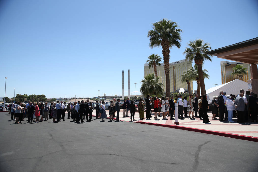 People wait in line to attend the installation of Rev. George Leo Thomas as the third Bishop of Las Vegas, at The Shrine of the Most Holy Redeemer in Las Vegas, Tuesday, May 15, 2018. Erik Verduzc ...