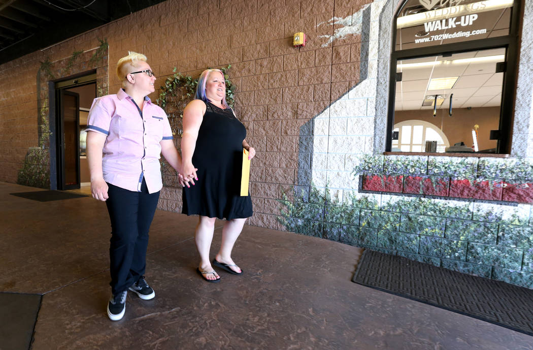 Tara, left, and Allie Shima of Stateline walk to their car after their wedding at Vegas Weddings chapel in downtown Las Vegas Thursday, May 17, 2018. K.M. Cannon Las Vegas Review-Journal @KMCannon ...