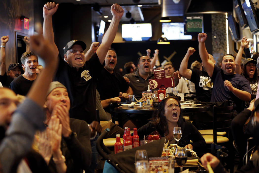 Marie Fuentes, of Las Vegas, reacts after the Vegas Golden Knights scored against the Winnipeg Jets during the second game of the Western Conference Final at MacKenzie River Pizza at the City Nati ...