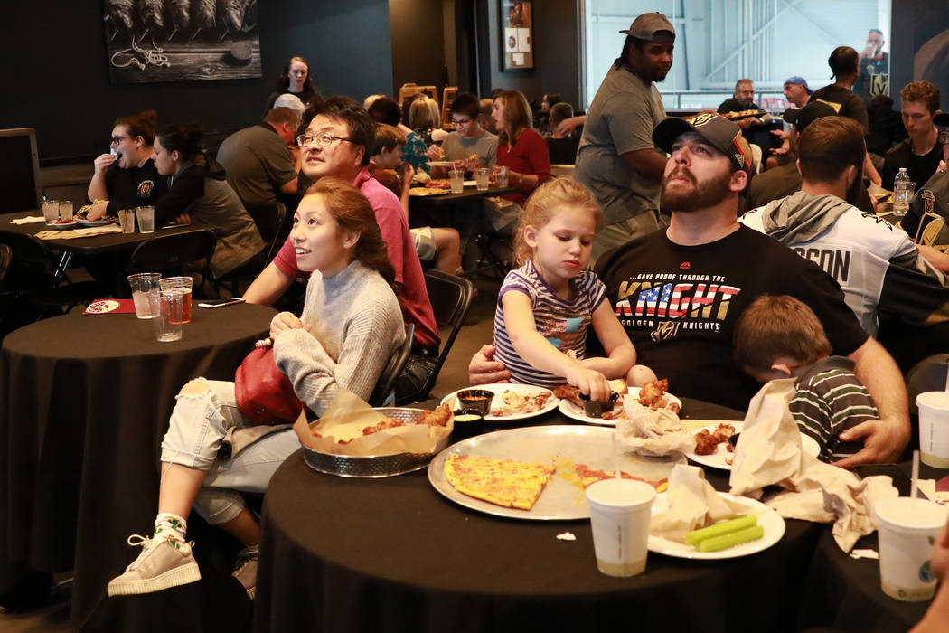 Vegas Golden Knights fans watch the the second game of the Western Conference Final against the Winnipeg Jets at MacKenzie River Pizza at the City National Arena in Las Vegas on Monday, May 14, 20 ...