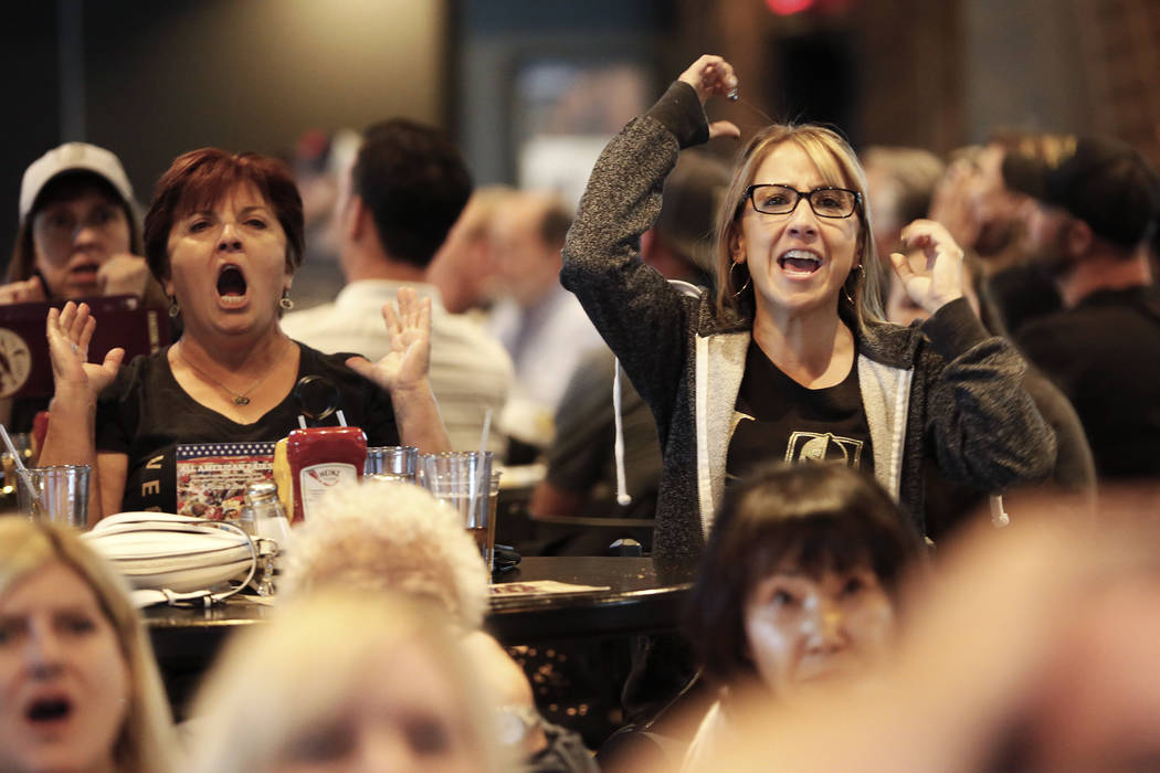 Kristina Byrd, of Las Vegas, cheers on the Vegas Golden Knights during the second game of the Western Conference Final at MacKenzie River Pizza at the City National Arena in Las Vegas on Monday, M ...