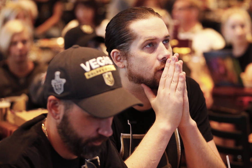 Jackson Loless, of Las Vegas, watches the Vegas Golden Knights play against the Winnipeg Jets during the second game of the Western Conference Final at MacKenzie River Pizza at the City National A ...