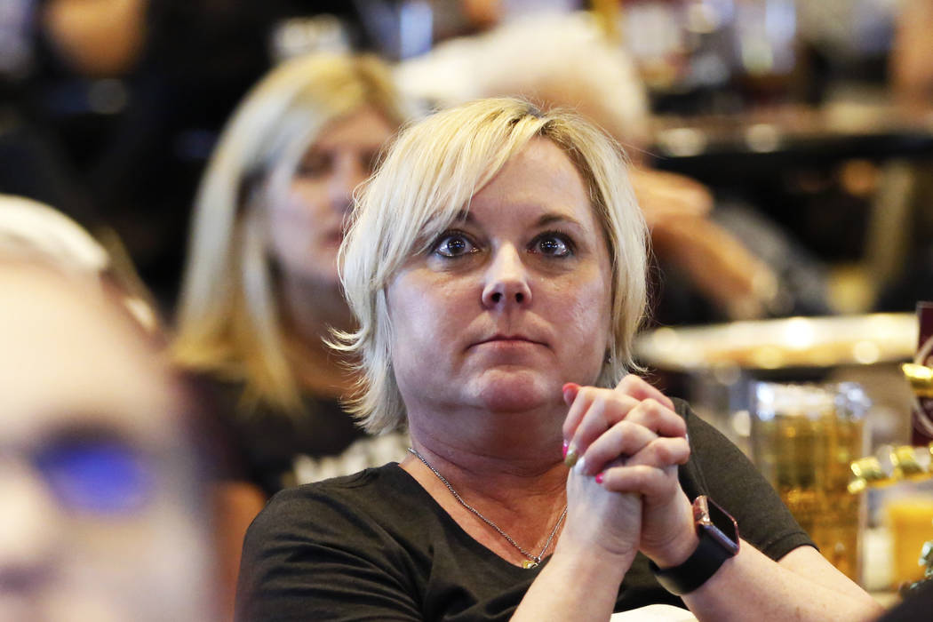 Holly Spicer, of Las Vegas, watches the Vegas Golden Knights play against the Winnipeg Jets during the second game of the Western Conference Final at MacKenzie River Pizza at the City National Are ...