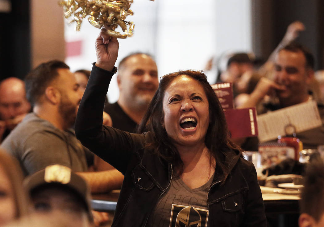 Marie Fuentes, of Las Vegas, cheers during the Vegas Golden Knights' second game of the Western Conference Final against the Winnipeg Jets at MacKenzie River Pizza at the City National Arena in La ...