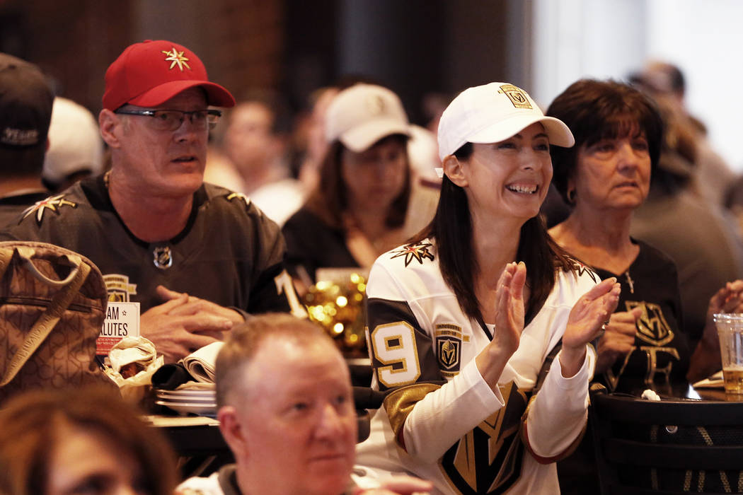 Roselina Trombley, of Las Vegas, cheers during the Vegas Golden Knights' second game of the Western Conference Final against the Winnipeg Jets at MacKenzie River Pizza at the City National Arena i ...