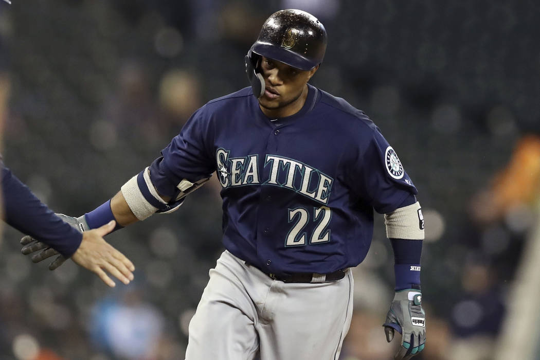 Seattle Mariners' Robinson Cano rounds third base after hitting a three-run home run during the fifth inning of the second game of a baseball doubleheader against the Detroit Tigers, Saturday, May ...