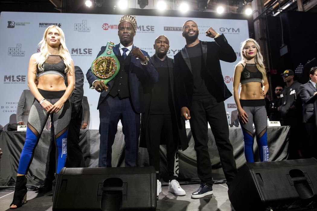 WBC light heavyweight title holder Adonis Stevenson, second from left, and Badou Jack, second from right, pose for a photo after a boxing press conference at the Rec Room in Toronto, Thursday, May ...