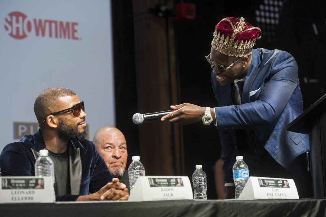 WBC light heavyweight title holder Adonis Stevenson, right, gives the microphone to competitor Badou Jack during a boxing press conference at the Rec Room in Toronto, Thursday, May 17, 2018. Jack ...