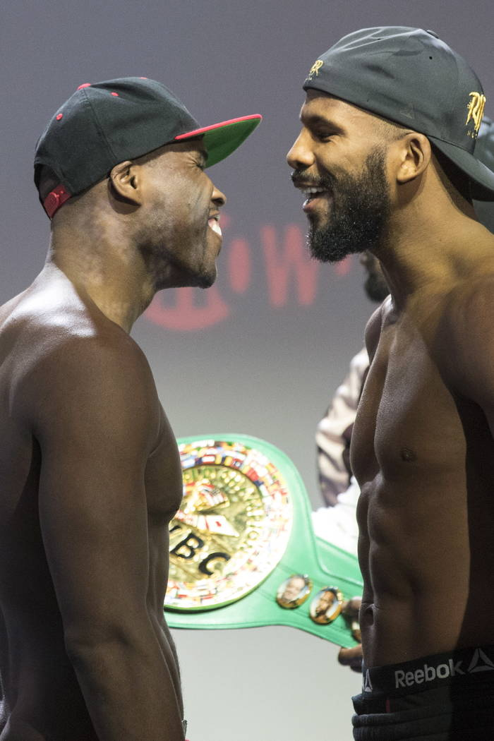 Adonis Stevenson, left, and Badou Jack, right, face off after their weigh-in, in Toronto on Friday, May 18, 2018. Stevenson is slated to defend his WBC light heavyweight title against Jack on Satu ...