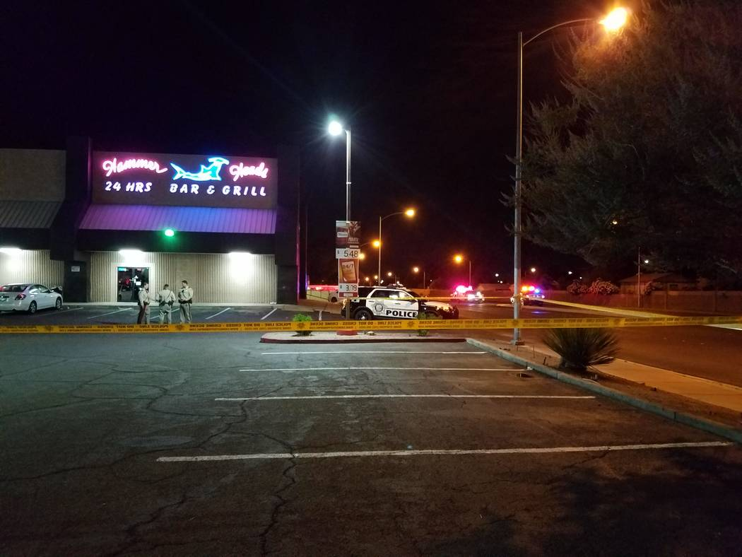 Metropolitan Police Department officers talk with one another at a location not far from the scene of an officer-involved shooting Saturday night on Big Sur Drive in the east Las Vegas Valley. (Mi ...