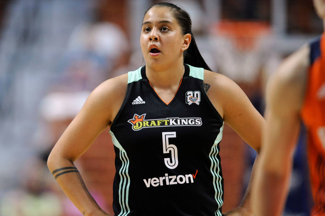 FILE - In this June 16, 2016, file photo, New York Liberty's Shoni Schimmel watches during the first half of a WNBA basketball game in Uncasville, Conn. Schimmel is back with the New York Liberty ...