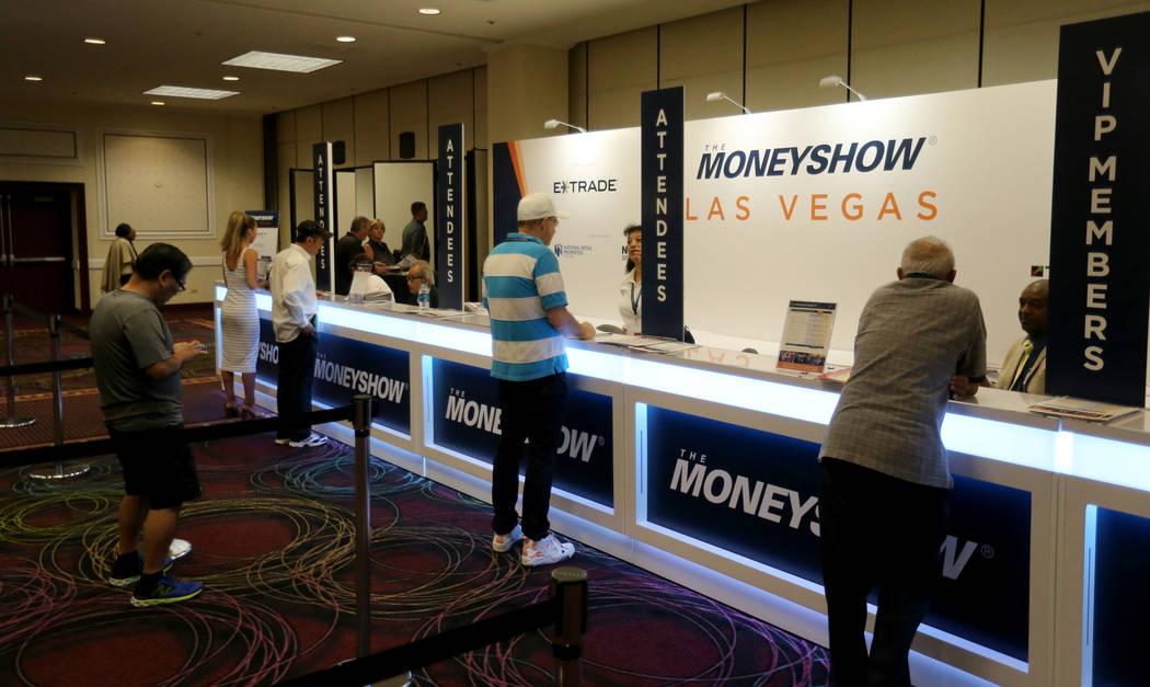 Conventioneers check in for The MoneyShow Las Vegas at Bally's Tuesday, May 15, 2018. K.M. Cannon Las Vegas Review-Journal @KMCannonPhoto