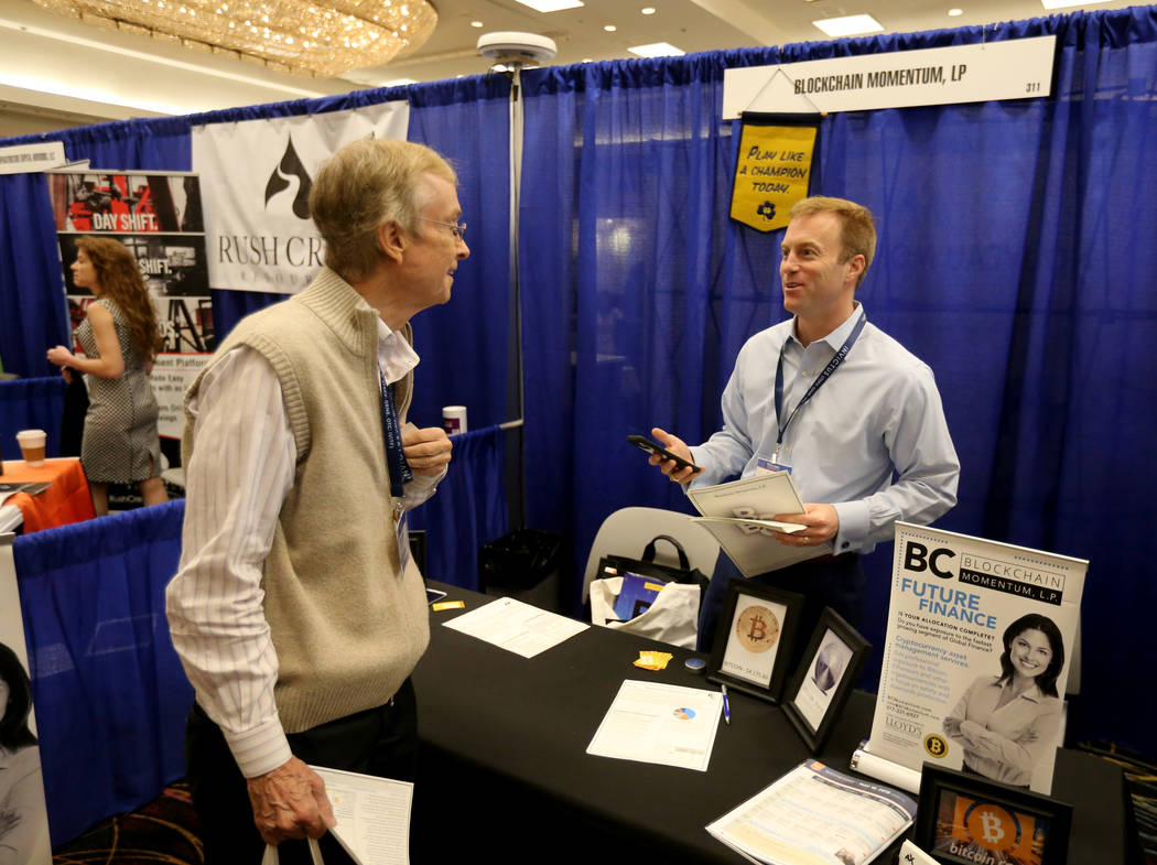 John Sarson of Momentum Investing talks to Joseph Umbach of West Palm Beach, Fla. about cryptocurrency at The MoneyShow Las Vegas at Bally's Tuesday, May 15, 2018. K.M. Cannon Las Vegas Review-Jou ...