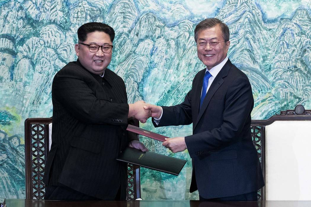 North Korean leader Kim Jong Un, left, and South Korean President Moon Jae-in shake hands after signing on a joint statement at the border village of Panmunjom in the Demilitarized Zone, South Kor ...