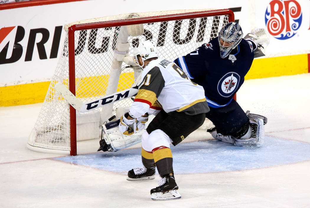 Vegas Golden Knights center Jonathan Marchessault (81) scores against Winnipeg Jets goaltender Connor Hellebuyck (37) during the third period in Game 2 of an NHL hockey third round playoff series ...