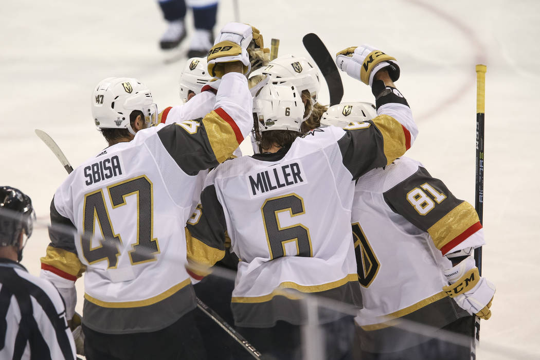 The Vegas Golden Knights celebrate a third period goal by Jonathan Marchessault (81) against Winnipeg Jets in Game 2 of an NHL hockey third round playoff series at the Bell MTS Place in Winnipeg, ...
