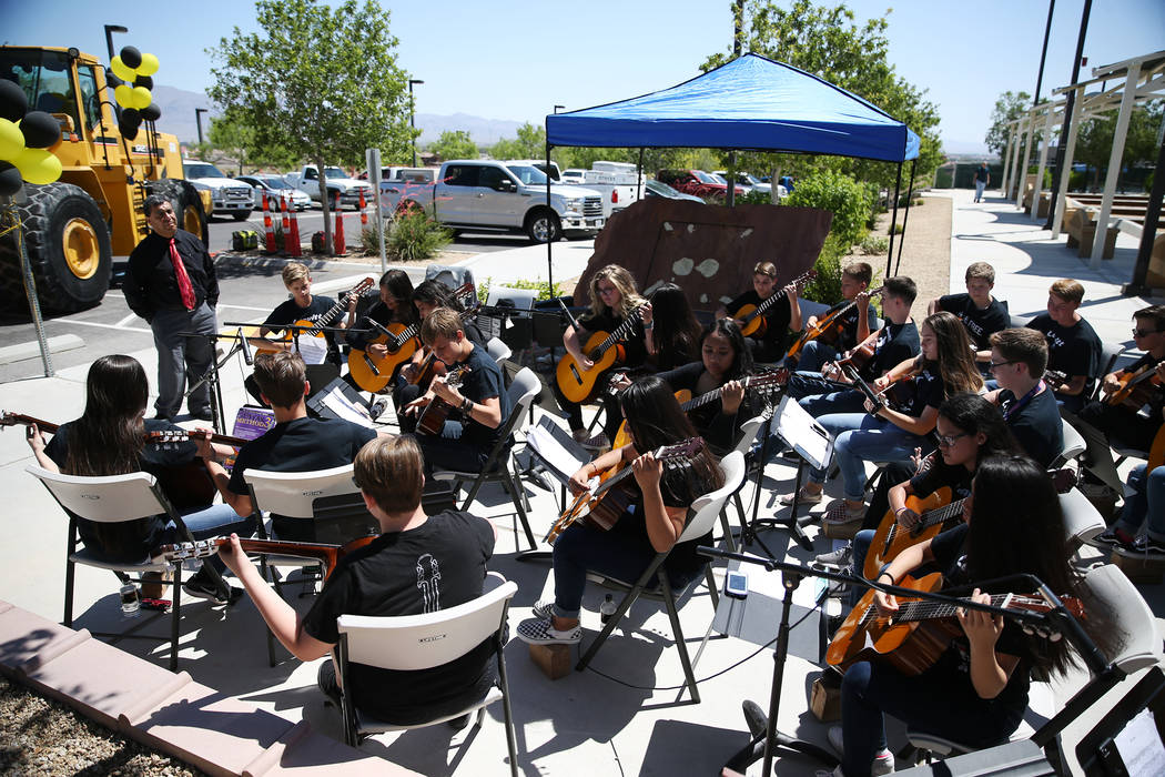 Leavitt Middle School advance guitar students play during the Lone Mountain Road Improvement Project start celebration at the Lone Mountain Regional Park in Las Vegas, Thursday, May 17, 2018. Erik ...