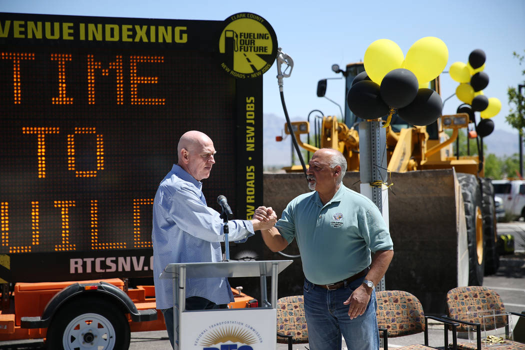 Clark County Commissioner Larry Brown, left, and Las Vegas Councilman Stavros Anthony during the Lone Mountain Road Improvement Project start celebration at the Lone Mountain Regional Park in Las ...