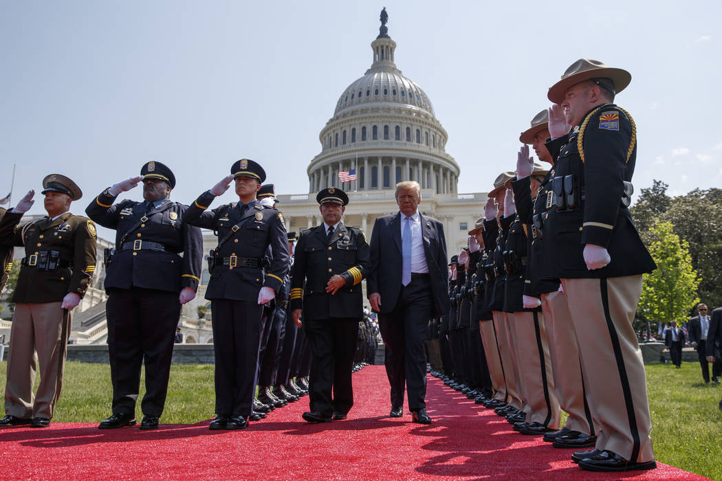 President Donald Trump arrives for the 37th annual National Peace Officers Memorial Service on Capitol Hill, Tuesday, May 15, 2018, in Washington. (AP Photo/Evan Vucci)