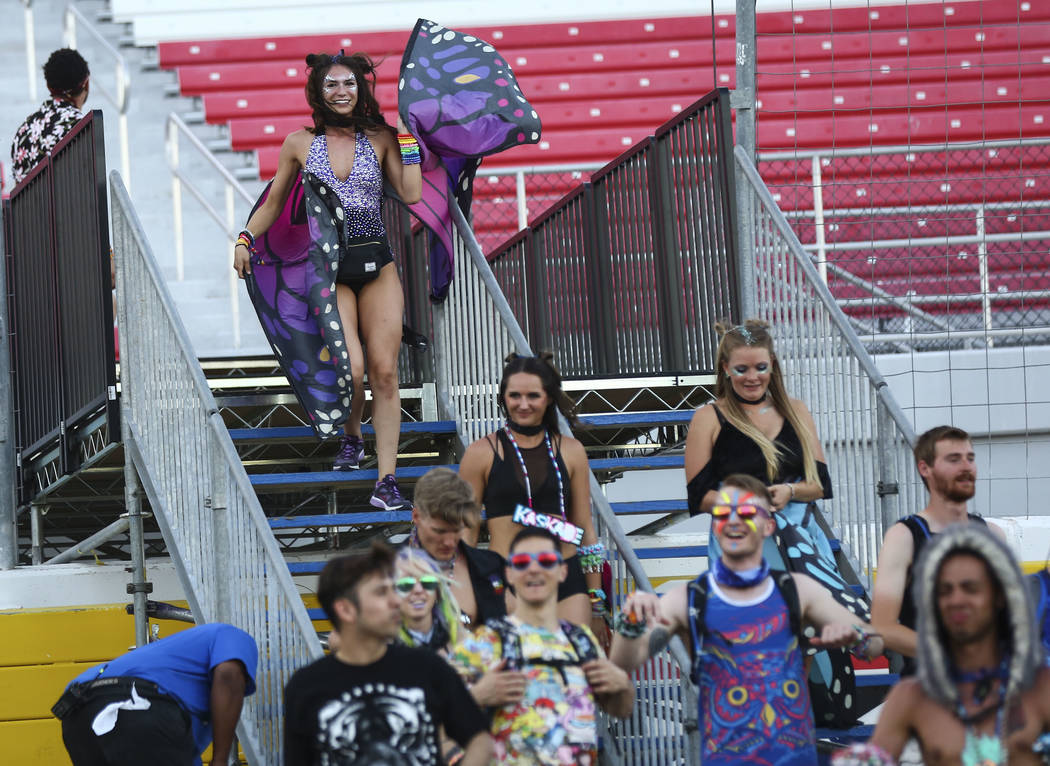Attendees, including Malynn Nelson of Salt Lake City, Utah, upper left, arrive for the first day of the Electric Daisy Carnival at the Las Vegas Motor Speedway in Las Vegas on Friday, May 18, 2018 ...