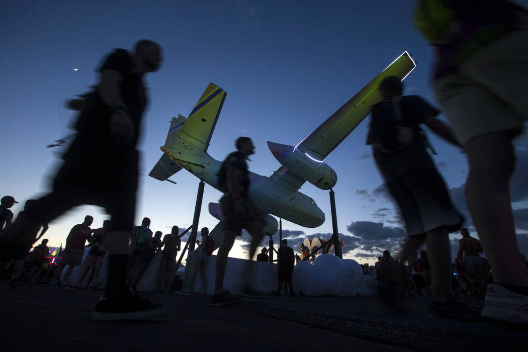 Attendees walk by the Ghost Ride art installation during the first day of the Electric Daisy Carnival at the Las Vegas Motor Speedway in Las Vegas on Friday, May 18, 2018. Chase Stevens Las Vegas ...