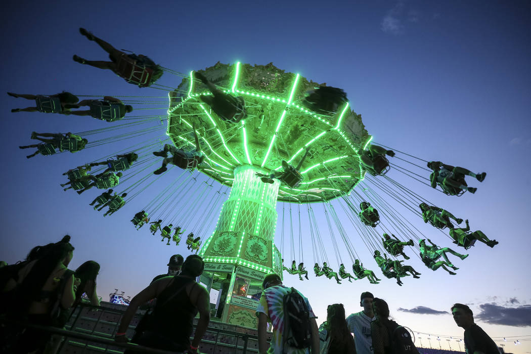 Festivalgoers swing on a fairground ride on day one of the Electric Daisy Carnival at the Las Vegas Motor Speedway on Friday, May 18, 2018. Richard Brian Las Vegas Review-Journal @vegasphotograph