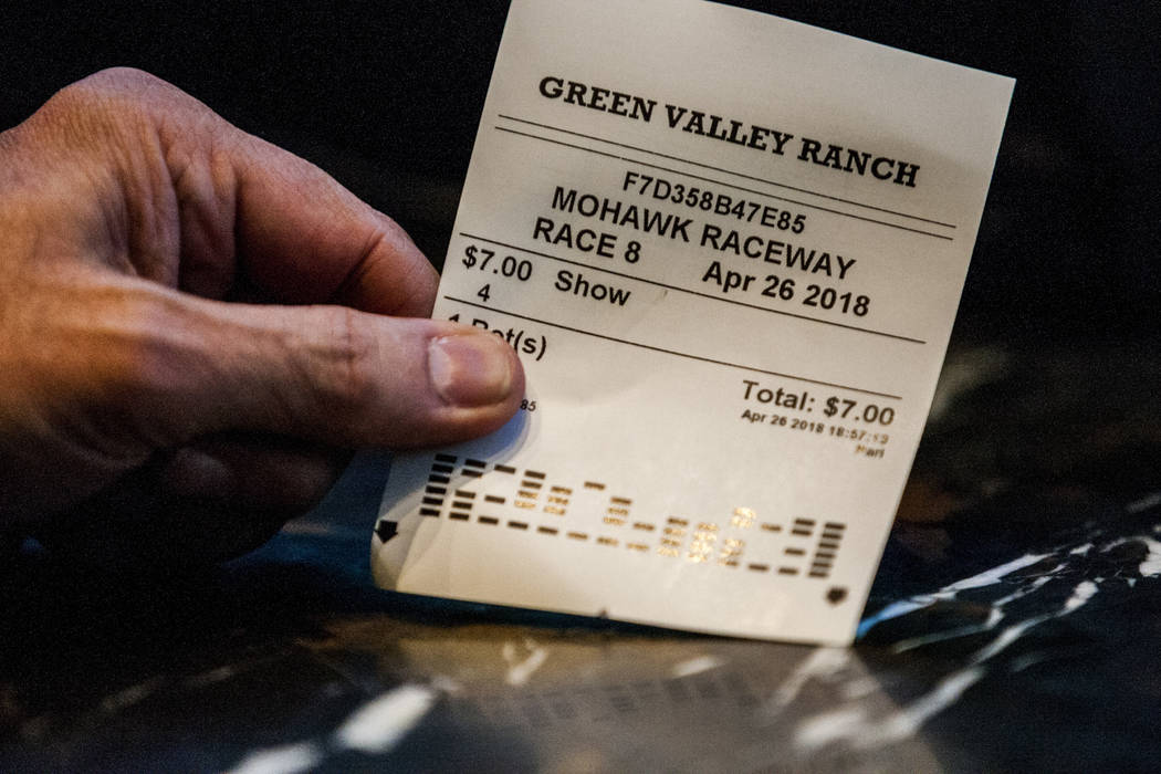A sports better displays his ticket from a horse race at the Green Valley Ranch sports book in Henderson on Thursday, April 26, 2018. Patrick Connolly Las Vegas Review-Journal @PConnPie