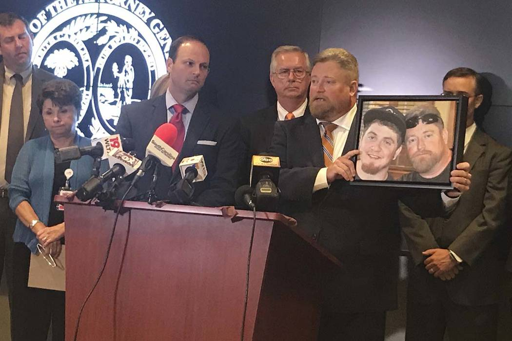 South Carolina Attorney General Alan Wilson, left, stands next to Rep. Eric Bedingfield, whose son died last year of a drug overdose, on Tuesday, Aug. 15, 2017, at his offices in Columbia, S.C. Wi ...