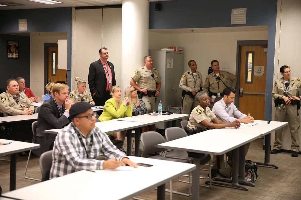 Members of the press with Las Vegas Police officers attend a presentation during the Stepping Up Initiative Day of Action at the Clark County Detention Center in Las Vegas, Wednesday, May 16, 2018 ...