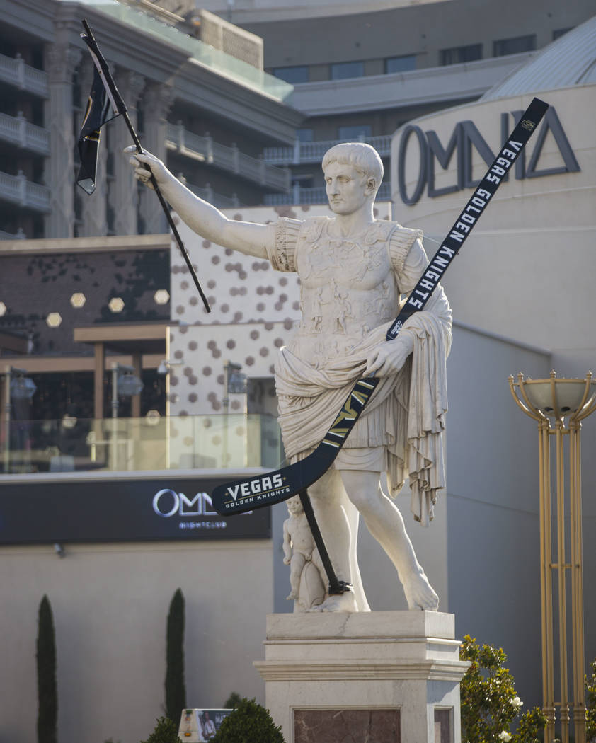 A statue of Julius Caesar is seen adorned with a Golden Knights flag and hockey stick outside of Caesars Palace in Las Vegas on Tuesday, May 15, 2018. Chase Stevens Las Vegas Review-Journal @csste ...