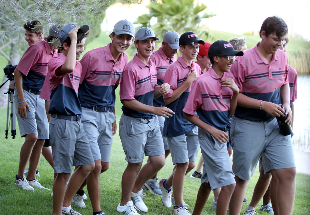 Members of the Coronado High School golf team react after winning the team Class 4A Nevada state championship at Reflection Bay Golf Club in Henderson Tuesday, May 15, 2018. K.M. Cannon Las Vegas ...