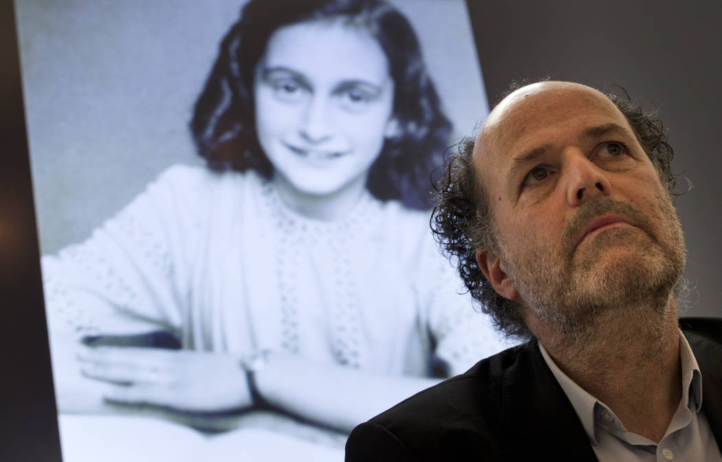 A picture of Anne Frank is projected as director Ronald Leopold of the Anne Frank Foundation listens during a press conference at the foundation's office in Amsterdam, Netherlands, Tuesday, May 15 ...