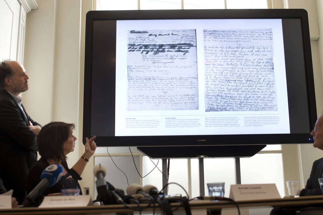 A video shows the text underneath two taped off pages from Anne Frank's diary during a press conference at The Anne Frank Foundation's office in Amsterdam, Netherlands, Tuesday, May 15, 2018. Left ...
