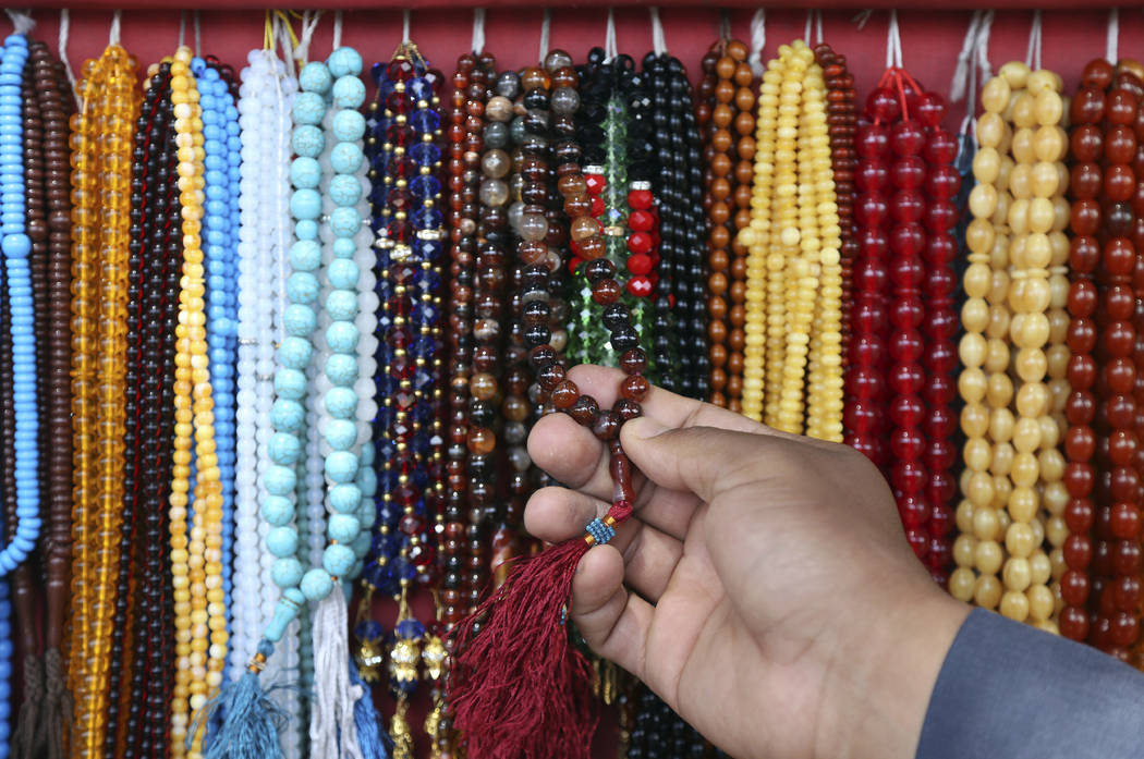 A customer purchases prayer beads ahead of the upcoming holy fasting month of Ramadan in Kabul, Afghanistan, Wednesday, May 16, 2018. Muslims across the world are observing the holy fasting month ...