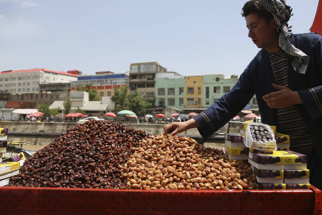 A street vendor sells dates ahead of the upcoming holy fasting month of Ramadan in Kabul, Afghanistan, Wednesday, May 16, 2018. Muslims across the world are observing the holy fasting month of Ram ...