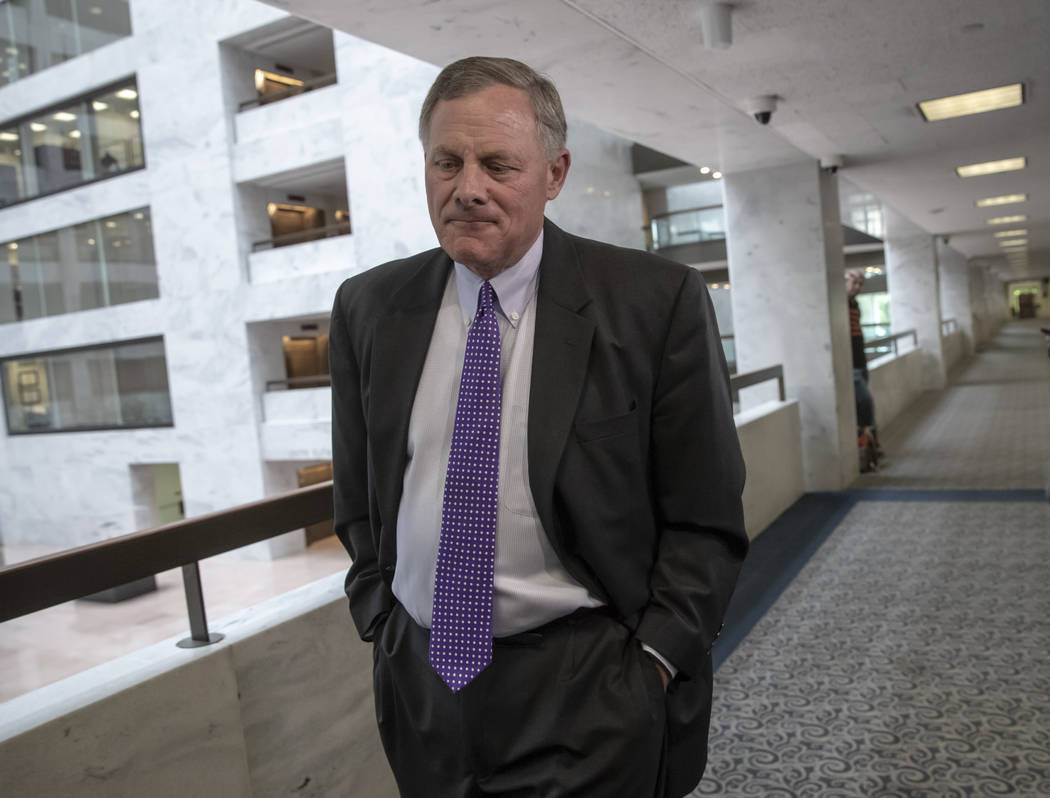 Senate Intelligence Committee Chairman Richard Burr, R-N.C., goes behind closed doors as members of the Senate Intelligence Committee arrive to meet with former national security chiefs on Russian ...
