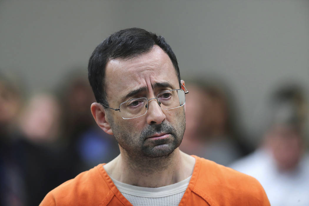 Dr. Larry Nassar appears in court for a plea hearing in Lansing, Mich. on Nov. 22, 2017. (AP Photo/Paul Sancya, File)