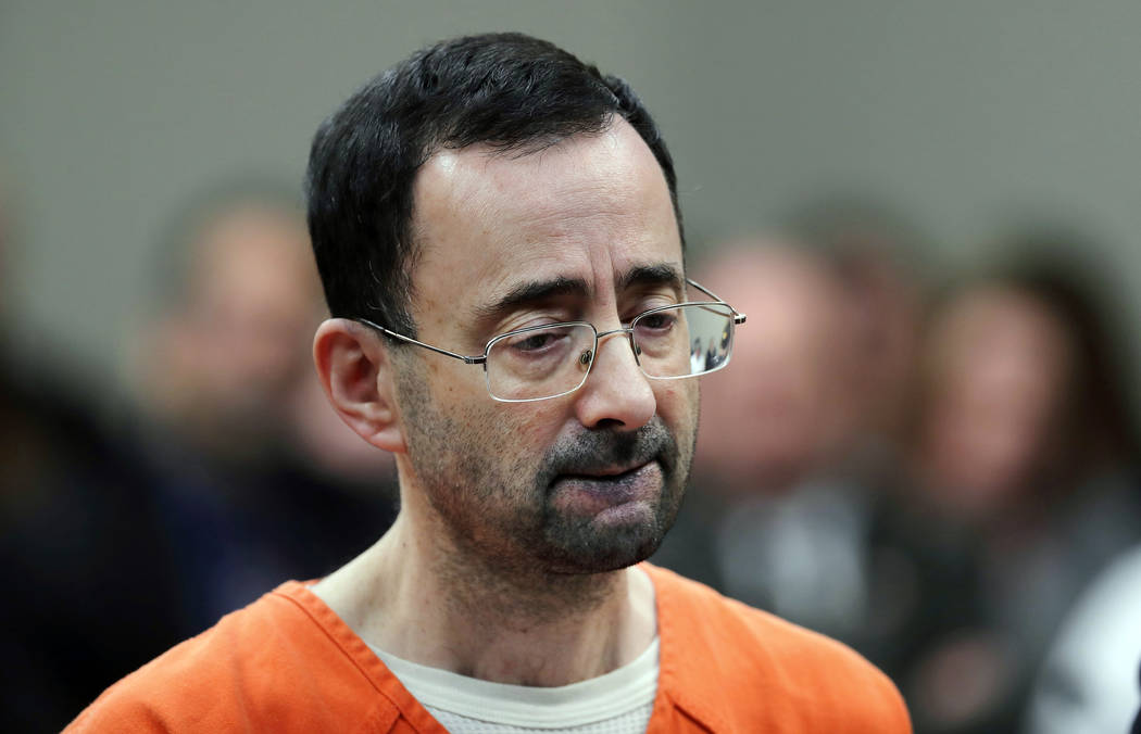 Dr. Larry Nassar, 54, appears in court for a plea hearing in Lansing, Mich. on Nov. 22, 2017. (AP Photo/Paul Sancya, File)