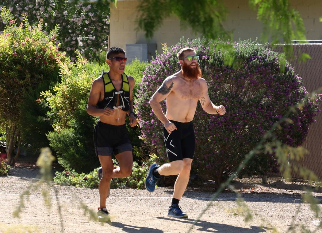 Runners run through Sunset Park on Wednesday, May 16, 2018, in Las Vegas. Bizuayehu Tesfaye/Las Vegas Review-Journal @bizutesfaye
