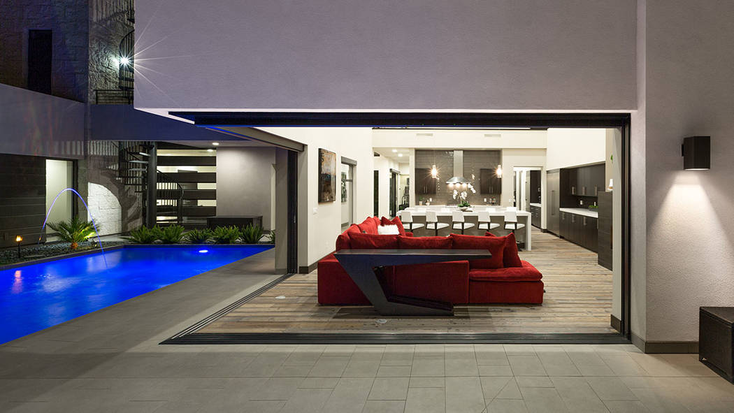 The home has disappearing walls to connect the indoor areas with the resort-style backyard. (The Red Luxury Real Estate)